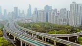 поднятый : busy traffic over overpass in modern city , Shanghai, China