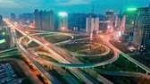 поднятый : skyline and traffic trails on highway intersection