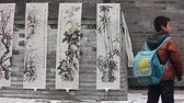 XIAN-DEC 29: Chinese painting works selled in street, Dec 29, 2012,Xian city, Shaanxi province, china. Stock Footage