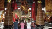 XIAN CHINA - MAY 27 2012: Buddhists pray inside the Temple