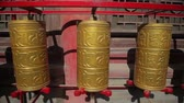 sculpture : golden prayer wheels in temple,China Stock Footage