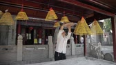 XIAN, CHINA - MAY 24, 2012: Visitors burn incense and pray in Daxingshan Temple