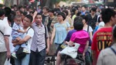 XIAN CHINA- MAY 26 2012: Crowd on street.