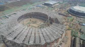 поднятый : XIAN, CHINA - MARCH 25, 2019: AERIAL shot of stadium being built,China
