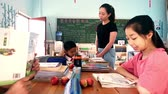 serio : Guangyuan, CHINA - JUNE 04, 2019: Schoolchild and teacher in classroom,China. Filmati Stock