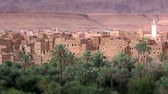 kasbah : Panorama of a village in Moroccan hills, Morocco, thousand Kasbah road. Oasis in Sahara desert area. Tilt-shift effect. Stock Footage