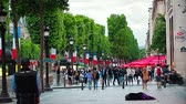 gipsy : PARIS, FRANCE - JULY 9, 2015: Woman begging on the street Champs Elysees while pedestrians passing by.