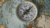 longitude : The compass arrow rotates on the geographical map of the world
