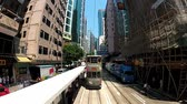 most : Hong Kong, China September 13, 2012: View from the upped deck of the double-deck tram passing by the street of Hong Kong, China. The double-deck trams system of Hong Kong is one of the most famous in the world.