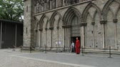 statue : Trondheim, Norway, June 27, 2013 - People exit from the Nidaros cathedral in Trondheim, Norway. Stock Footage