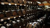 уксус : Modena, Italy - May 15 2013: View to the balsamic vinegar barrels for storing and aging in a cellar in Modena, Italy.