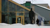 memorial : Longyearbyen, Norway - March 18, 2014: Exterior of the arctic coal mine worker statue at the street of the arctic town of Longyearbyen, Norway.