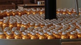 perfume : Grasse, France - April 10, 2014: Perfume bottles move by the transportation line at the Fragonard perfume factory in Grasse, France. Stock Footage