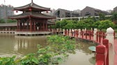 típico : Xian, China - May 29, 2013: View to the traditional style building in the Datang Furong Garden in Xian, China.