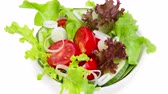 ingrediente : Fresh salad in a white bowl