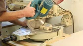плотничные работы : sliding miter saw cutting a board