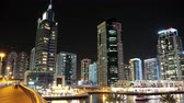 business : 4K Dubai Marina night time lapse, United Arab Emirates. Dubai Marina - the largest man-made marina in the world. Dubai Marina is a canal city, carved along a 3 km stretch of Persian Gulf shoreline Stock Footage