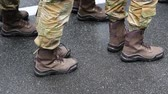harcias : Feet of soldiers. Servicemen at the military parade. Soldiers in military uniform Stock mozgókép
