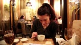 jantar : Woman eating miso soup in a Japanese restaurant