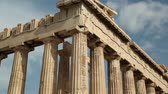 atina : Columns of Parthenon - antique temple in Athenian Acropolis in Greece, dedicated to the goddess Athena, whom the people of Athens considered their patron Stok Video