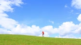 chapéus : Fellow in red shirt going on grass Stock Footage