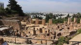 everlasting : People on ruins of ancient Carthage in Tunisia. Carthage is a major urban centre that has existed for nearly 3