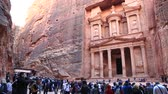 nabataean : JORDAN, PETRA, DECEMBER 5, 2016: People near Al Khazneh or the Treasury at ancient Petra, originally known to Nabataeans as Raqmu - historical and archaeological city in Hashemite Kingdom of Jordan