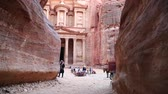 siq : JORDAN, PETRA, DECEMBER 5, 2016: People, horses and camel near Al Khazneh or Treasury at Petra, originally known to Nabataeans as Raqmu, historical and archaeological city, Hashemite Kingdom of Jordan Stock Footage