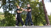 shu : UKRAINE, KIEV, SEPTEMBER 18, 2016: Demonstrations of martial arts at the third martial arts festival in Feofania park in Kiev. Event helps young people choose sport hobbies and find themselves in life