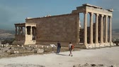 atina : GREECE, ATHENS, JUNE 7, 2013:  People near Erechtheion or Erechtheum - is an ancient Greek temple in Acropolis of Athens in Greece which was dedicated to both Athena and Poseidon