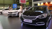 kia : KIEV, UKRAINE, MAY 31, 2013: Black KIA Cerato at yearly automotive-show SIA 2013 in Kiev, Ukraine, May 31, 2013