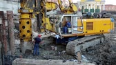 toiler : UKRAINE, KIEV, AUGUST 5, 2013: Builders on a construction site. Drilling wells for bored piles. Stock Footage