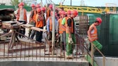 toiler : UKRAINE, KIEV, AUGUST 5, 2013: Team of workers at construction site in Kiev, Ukraine, August 5, 2013 Stock Footage