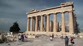 atina : GREECE, ATHENS, JUNE 7, 2013: People near Parthenon - ancient temple in Athenian Acropolis, Greece, June 7, 2013 Stok Video