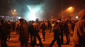 remonstrance : UKRAINE, KIEV, JANUARY 19, 2014: Thousands of anti-government protesters clashed with riot police, burning police buses and attacking with stones, sticks and fires after tough laws were passed.