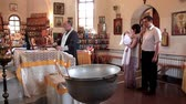 крещение : UKRAINE, KIEV, JUNE 15, 2011: Christening of little baby in the orthodox church. Infant baptism