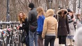 pacing : UKRAINE, KIEV, DECEMBER 15, 2009: Young people on the bridge of love in Kiev, Ukraine Stock Footage