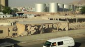 JORDAN, AQABA, DECEMBER 10, 2016: Container truck rides near industrial area with large capacity tanks close to Aqaba city, Hashemite Kingdom of Jordan