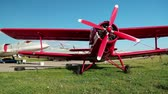 crop duster : UKRAINE, KIEV, AUGUST 23, 2016: Red small propeller-driven aircraft Antonov An-2 in Kiev aviation museum. Is a Soviet mass-produced single-engine biplane. Agricultural and utility aircraft Stock Footage