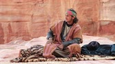 nabataean : JORDAN, PETRA, DECEMBER 5, 2016: Jordanian bedouin in ancient Petra, originally known to Nabateans as Raqmu - historical and archaeological city in Hashemite Kingdom of Jordan