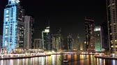 UHD 4K Dubai Marina night time lapse, United Arab Emirates. Dubai Marina is the largest man-made marina in the world. Dubai Marina is a canal city, carved along a 3 km stretch of Persian Gulf shoreline
