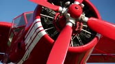 Red old propeller-driven aircraft Stock Footage