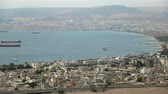 Panorama of Aqaba in Jordan and Eilat city in Israel. View from mountain in Aqaba city in Jordan. Two city and two country in one video clip