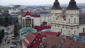 stanislav : View on the Greek Catholic Cathedral of the Holy Resurrection in Ivano-Frankivsk city from Ratusha or Town Hall - building in center of Ivano-Frankivsk city on Rynok or Market Square, western Ukraine Stock Footage