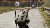 harcias : Ancient ballista. Crossbow is aimed at a target. Old wooden arbalest and targets at background