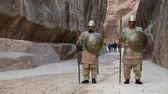 siq : JORDAN, PETRA, DECEMBER 5, 2016: Nabatean soldiers and people in Siq - a narrow passage that leads to Petra, originally known to Nabataeans as Raqmu - historical and archaeological city in Jordan