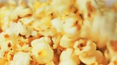 kernels : Close-up of popcorn pours down and fills the frame.