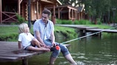 pesca : Dad and son fishing on pier Stock Footage