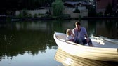 prole : Family in boat on lake