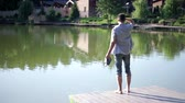 doca : Young man on the lake